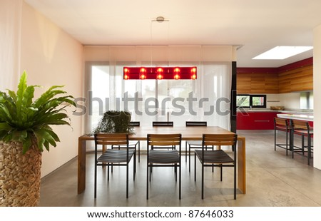 comfortable modern apartment, wooden dining table