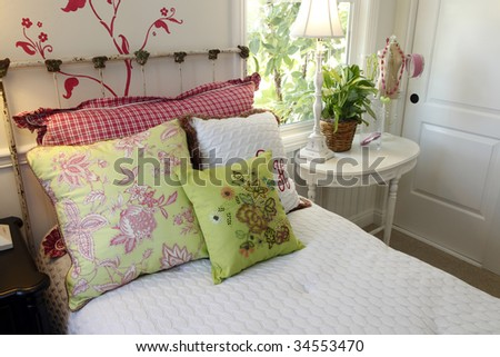 Comfortable modern bedroom with colorful pillows. - stock photo