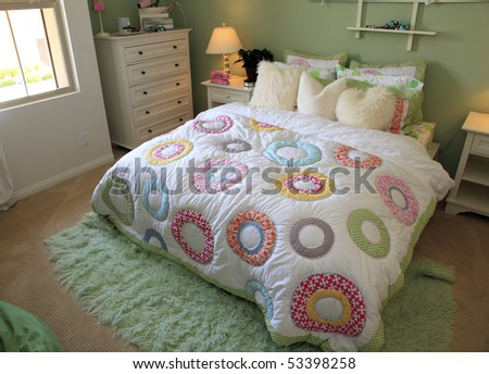 Comfortable modern bedroom with stylish furniture and decor. - stock photo