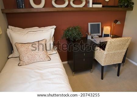 Comfortable modern designer bedroom with a desk. - stock photo