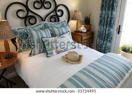 Comfortable modern designer bedroom with stylish furniture and decor. - stock photo