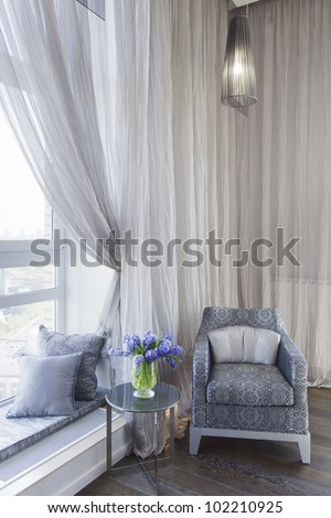 comfortable room corner, leather chair and tea table by the wind - stock photo