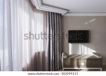 comfortable room corner, one chair by the window - stock photo