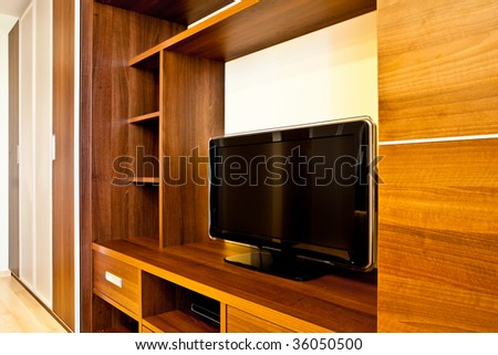 Comfortable room with TV and wardrobes - stock photo