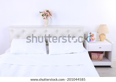 Comfortable soft bed in room - stock photo