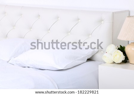 Comfortable soft bed with pillows - stock photo