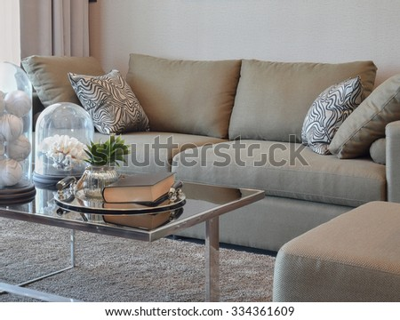 comfortable velvet sofa with grey striped pillows in modern living room - stock photo