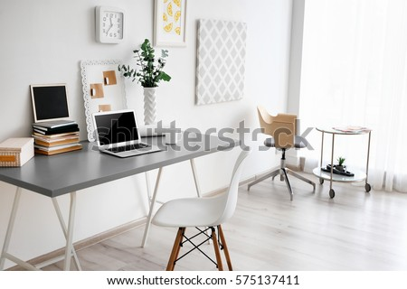 comfortable office. Comfortable Workplace With Laptop In Office