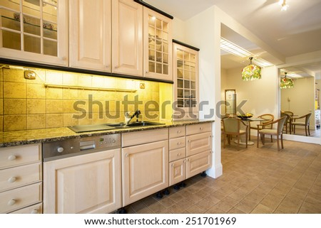 Comfy kitchen interior inside traditional style house - stock photo