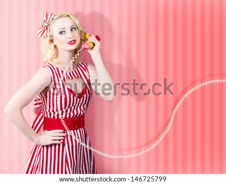 Comic retro photo of a housewife in 1950s fashion style gossiping on a vintage banana phone - stock photo