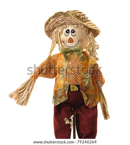 Comic stuffed smiling scarecrow dressed in colorful rag clothes. Pure white background for easy removal. Could be Halloween image. - stock photo