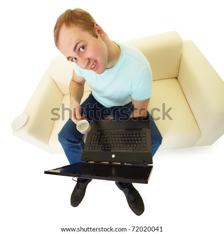 comical emotional man with a laptop and a cup of coffee sitting on the couch - stock photo