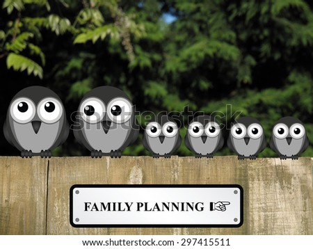 Comical family planning sign with large family of birds perched on a timber garden fence against a foliage background                                - stock photo