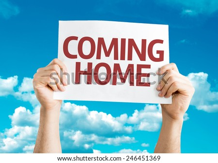 Coming Home card with sky background - stock photo