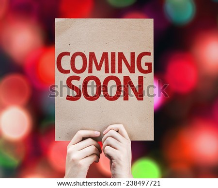 Coming Soon card with colorful background with defocused lights - stock photo