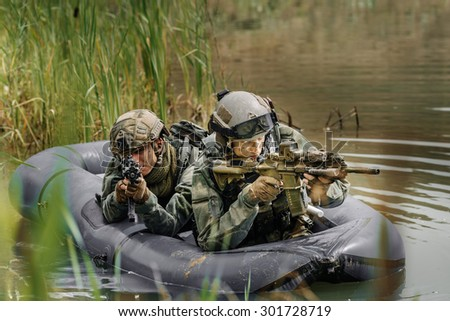 command rangers during the military operation in water - stock photo
