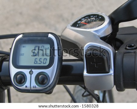 command table, speed meter and gear shifter of the modern off-road mountain bicycle - stock photo