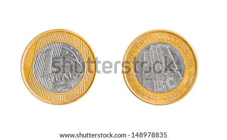 Commemorative coin of one Brazilian real isolated on white background showing the two sides of the coin, good for representing money in emerging countries. Shows the appearance of money in Brazil.