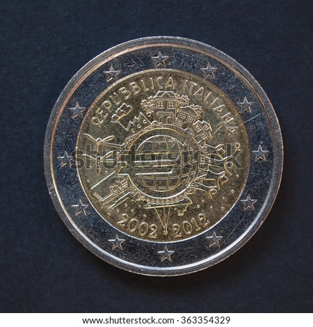 Commemorative 2 Euro coin (Italy 2012 - 10th anniversary of Euro currency circulating) over black background