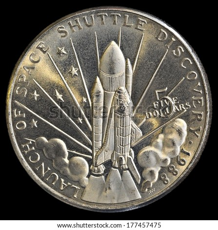 Commemorative Silver Coin for the Launch of the Space United States Space Shuttle Discovery  - stock photo