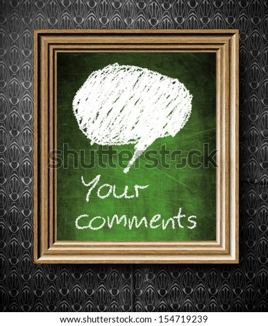 Comments and bubble speech with copy-space chalkboard in old wooden frame on vintage wall - stock photo