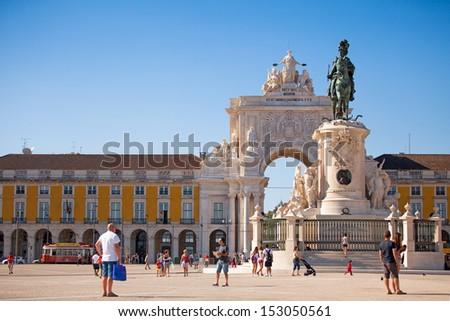 Commerce Square with Rua Augusta Triumph Arch in the background. Lisbon, Portugal. - stock photo