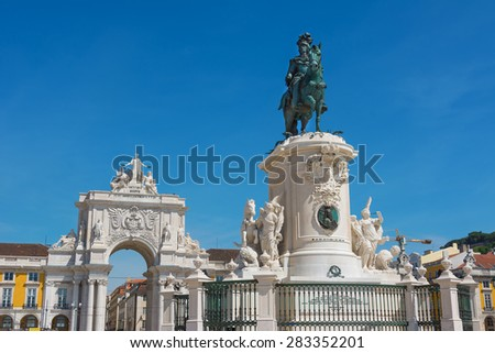 Commerce Square with statue of King Jose and the triumphal arch Lisbon Portugal - stock photo