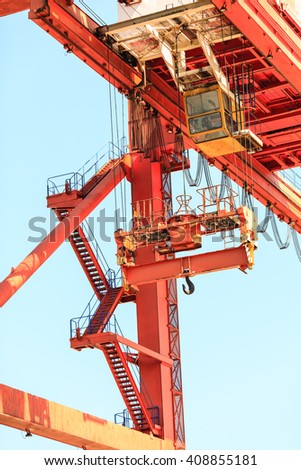 Commerce transport industry cargo machine technology concept. Lonely crane in port. Industrial device in maritime facility.  - stock photo