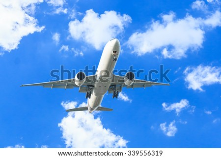 Commercial air plane flying with blue sky - stock photo