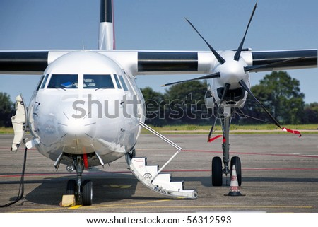 Commercial aircraft, seen from the font - stock photo