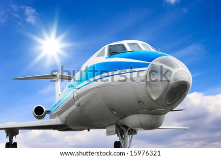 Commercial airliner against sunny sky - stock photo