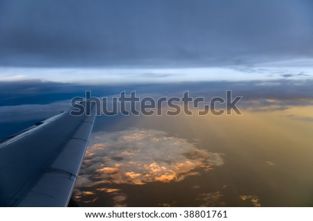 Commercial airliner flying at Sunset at 34,000 feet
