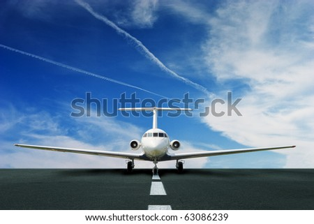 Commercial airliner on runway - stock photo