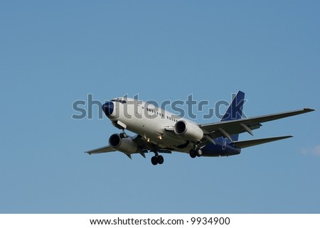 Commercial airplane against clear blue sky - stock photo
