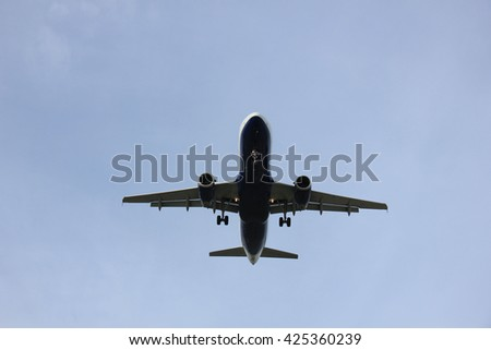 Commercial airplane approaching the runway - stock photo