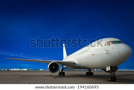 Commercial airplane at night - stock photo