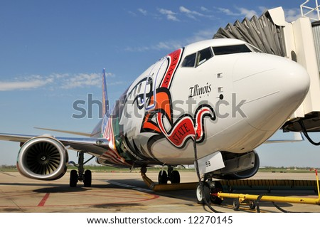 Commercial airplane at the airport on a sunny day - stock photo