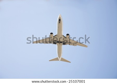 Commercial airplane image from bottom on a sunny day