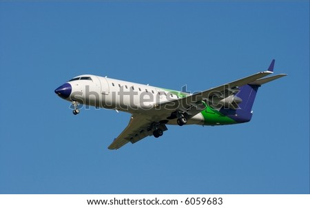 Commercial airplane landing against clear blue ky - stock photo