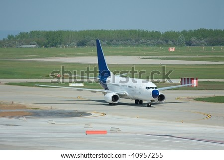 commercial airplane on the runway of the airport - stock photo