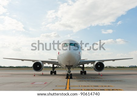 Commercial airplane parking at the airport - stock photo