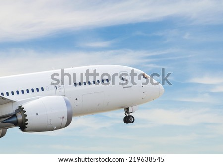 Commercial airplane taking off - stock photo