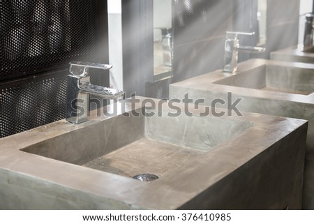 Commercial bathroom, Interior house, elegant wash basins in stylish bathroom  - vintage effect style pictures - stock photo