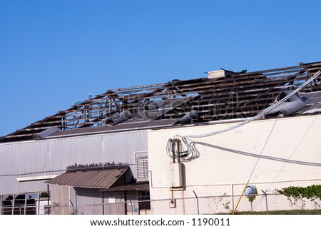 Commercial building destroyed by hurricane winds - stock photo