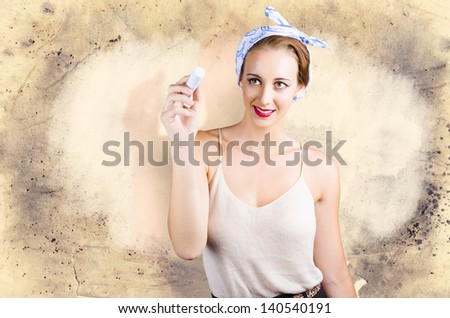 Commercial cleaning woman writing housework ad on grunge wall - stock photo