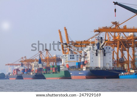 commercial container ship on port use for water transport and ship yard crane loading goods - stock photo