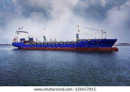 Commercial Container Ship with Dramatic Sky - Aveiro - Portugal - stock photo