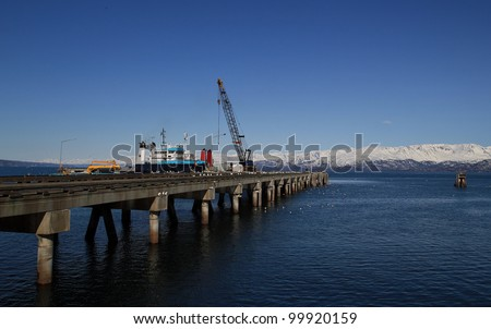 Commercial deep dock shipping pier in Homer Alaska on a sunny day. - stock photo