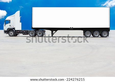 commercial delivery cargo container truck with white trailer blank for design against blue sky - stock photo
