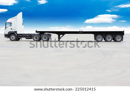 commercial delivery cargo truck with trailer blank for design against blue sky - stock photo